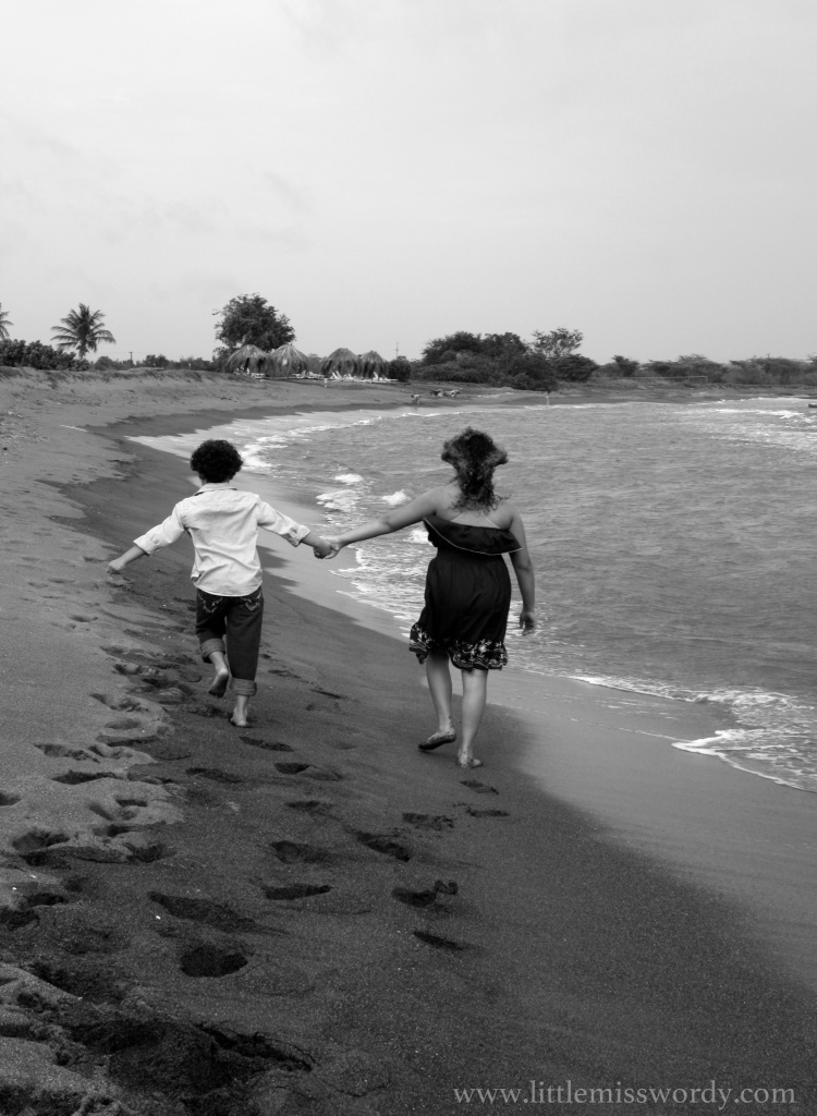 beach, holding hands, walk on the beach, sandy days, compassion, siblings, parenting, family